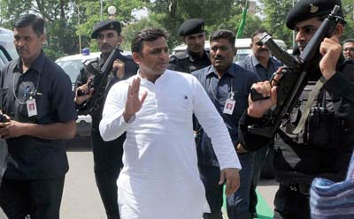 """JAIPUR, INDIA - SEPTEMBER 25: Uttar Pradesh Chief Minister Akhilesh Yadav at the National Convention of All India Yuva Yadav Mahasabha, at Birla Auditorium, on September 25, 2015 in Jaipur, India. Yadav called upon youth that if they want """"quota"""" in jobs then demand it with etiquette so that no one can raise finger. (Photo by Himanshu Vyas/Hindustan Times via Getty Images)"""